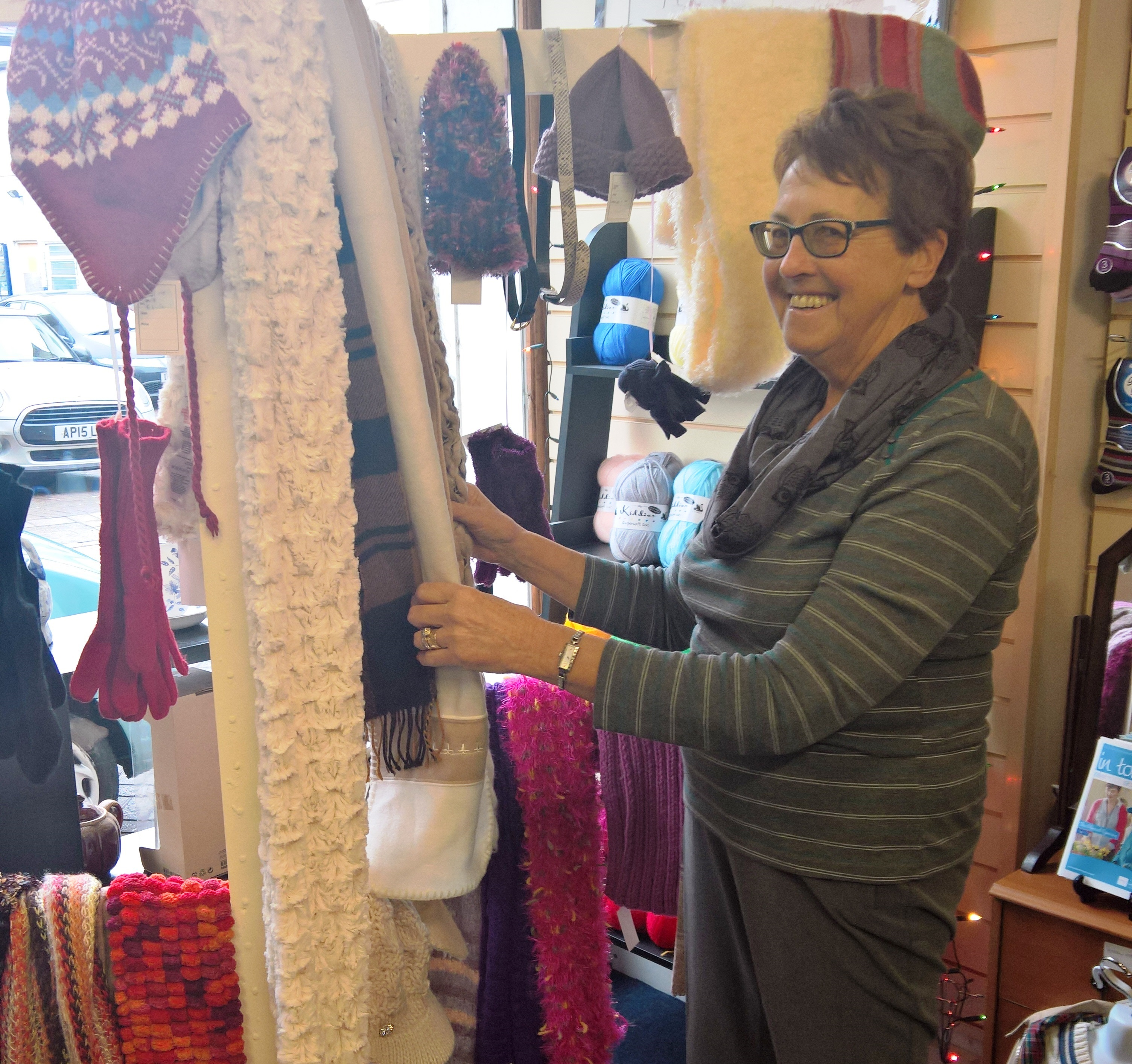 Retail Volunteer Pat organising the Wisbech shop window display
