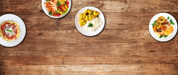 four dishes on a wooden background