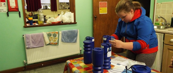 Child cleaning a collection pot