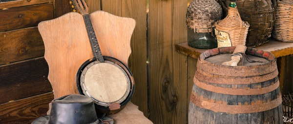 Western hat, instrument, barrel and bottles
