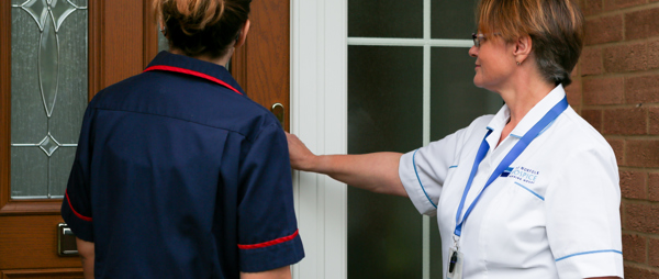 Two nurses at a door