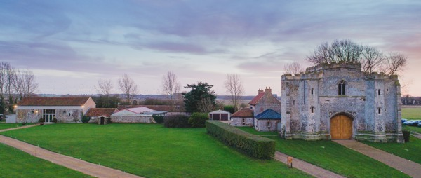 landscape of pentney abbey at dusk