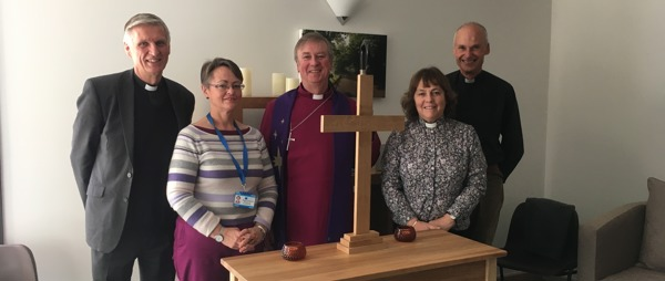 five people with the alter and alter cross