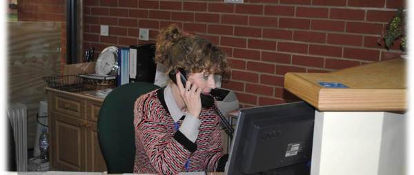 Ward Volunteer answering the phone