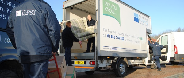 Warehouse volunteers loading furniture onto a van