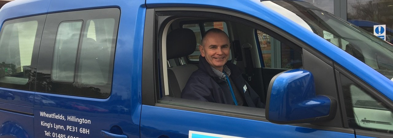 patient transport driver in a hospice vehicle