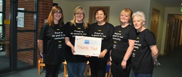 five ladies from Marks and Spencers holding a thank you sign