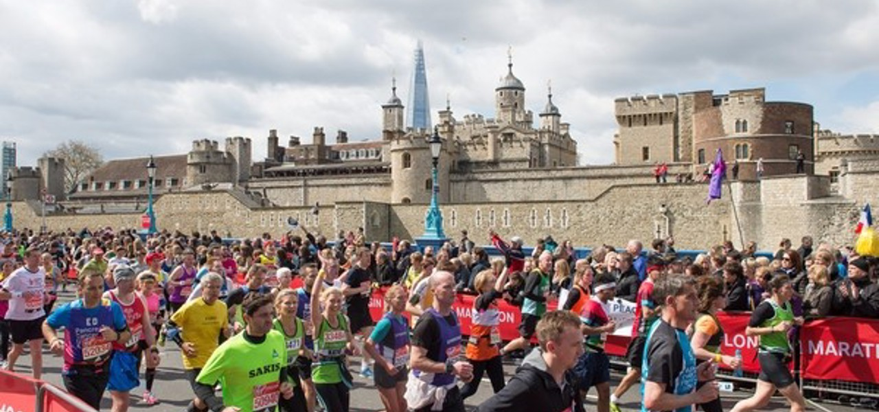 London Marathon runners run past the Tower of London