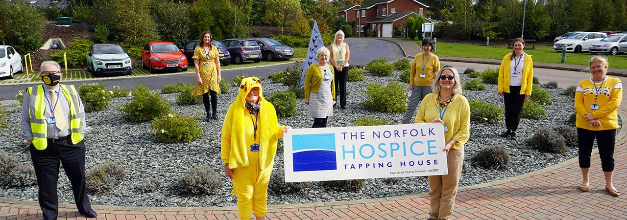 Staff at The Norfolk Hospice wearing yellow to celebrate Hospice Care Week
