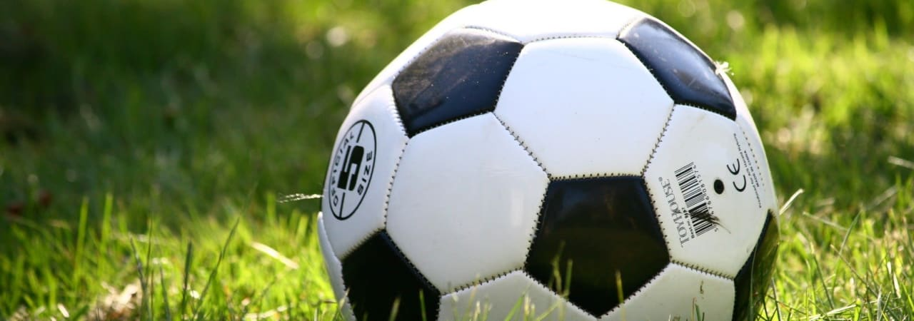A football in a patch of grass