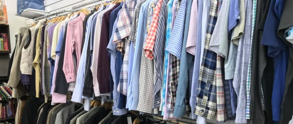Rows of clothing for sale in one of our charity shops