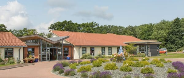 The front of the hospice with lavender flowering