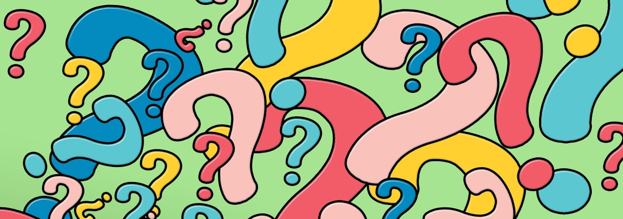multi coloured question marks on a green background