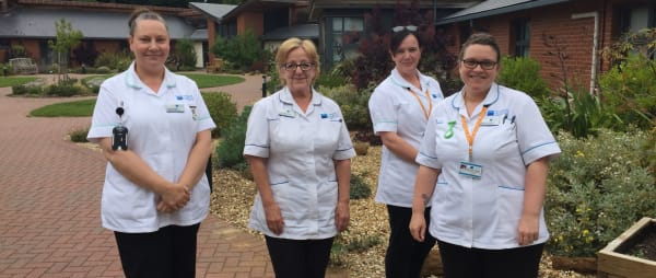 Nurses standing outside the hospice
