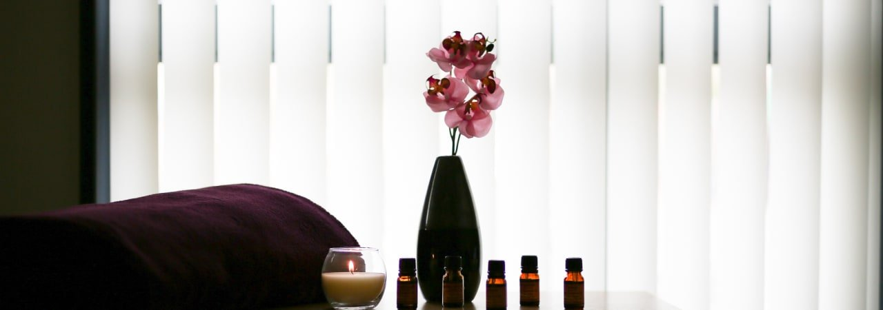 Complementary therapy setting with flower and candles